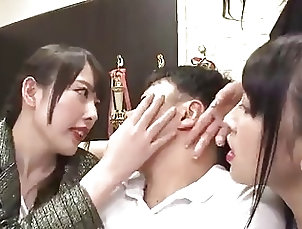 Three women smother a guy with kisses Three women smother a guy with kisses