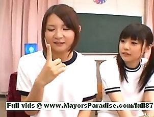 Teen japanese schoolgirls in the classroom Teen japanese schoolgirls in the...
